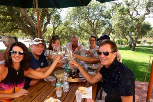 Hikers drink local red and white wine