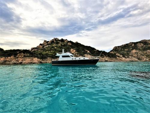Motor boat in the blue sea of the La Maddalena Archipelago
