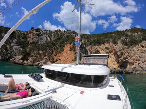 Girls relax aboard a catamaran