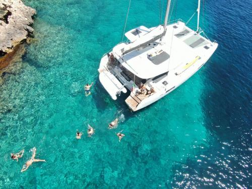 View of a catamaran from above in the waters of Alghero
