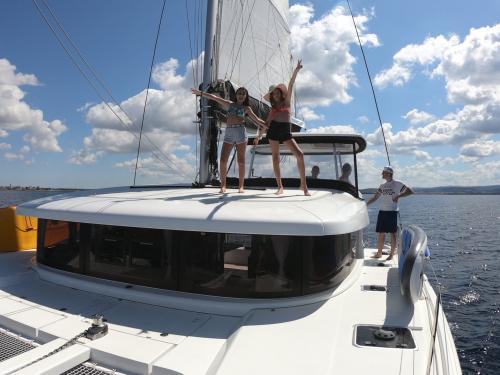Little girls on board a catamaran