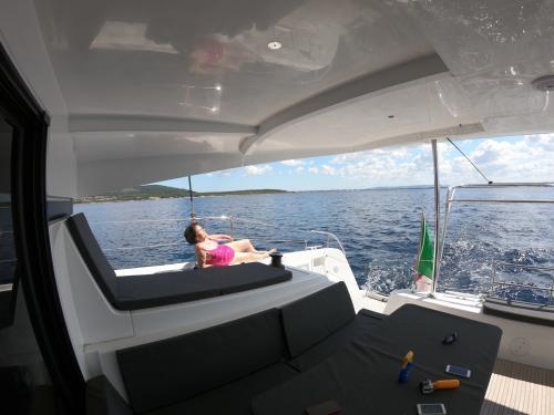 Lady aboard a catamaran