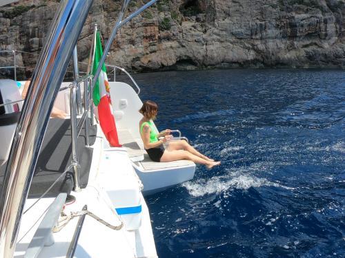 Girl on board a catamaran