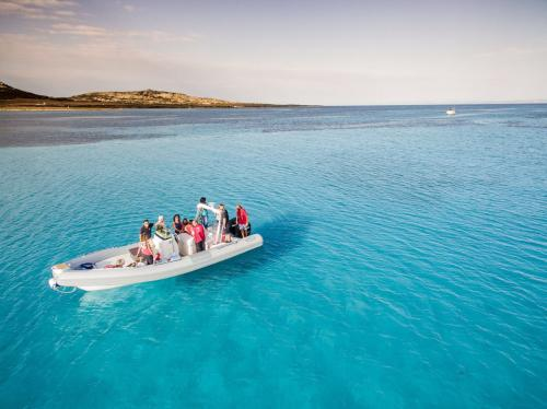 Rubber boat in the turquoise sea of the Asinara Gulf