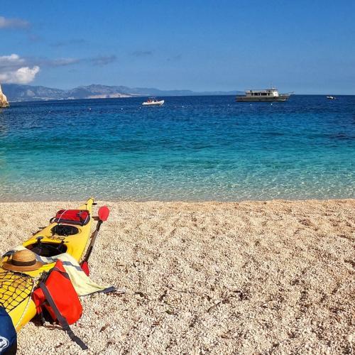 Kayaking on the beach facing the turquoise sea of the Gulf of Orosei