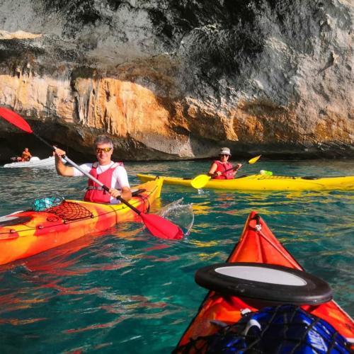 People in kayaks during excursion