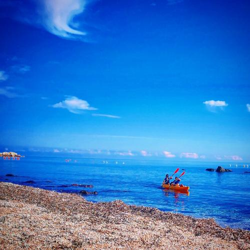 Kayak hikers in the turquoise sea