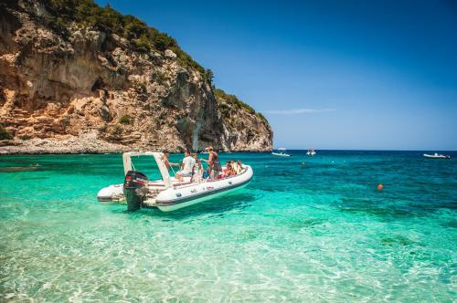 Inflatable boat in crystal clear waters