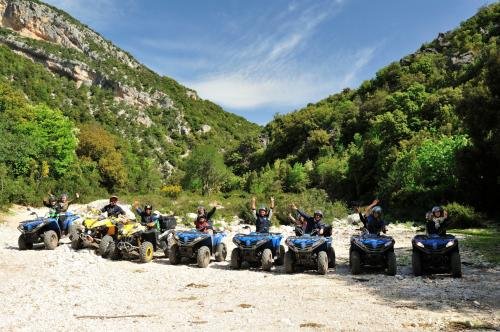 Group of hikers on quad bikes