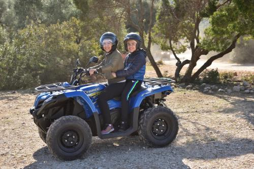 Mom and son on quad