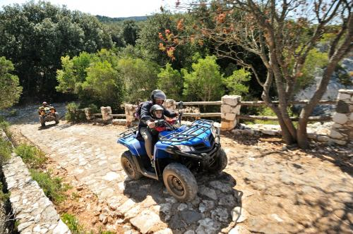 Father and son on quad bike