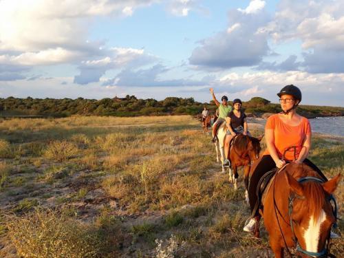 Group of hikers on horseback in Irgoli