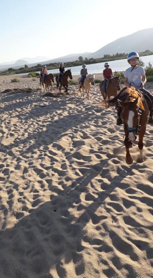 Horseback riding on the beach in Orosei