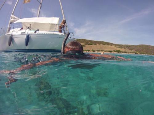 Boy snorkels during sailing excursion
