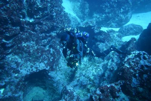 Hiker during a guided diving excursion in the waters of Alghero