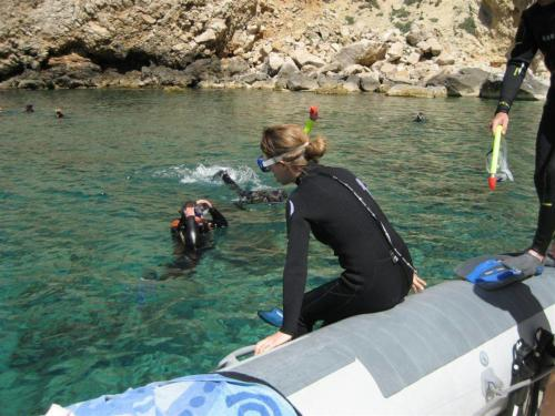 Girl ready to dive from the dinghy