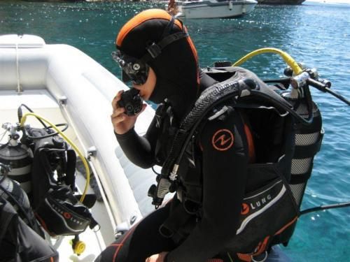 Hiker ready to dive into the sea of Alghero with diving equipment