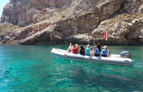 Transfer by raft for snorkeling excursion in Capo Caccia