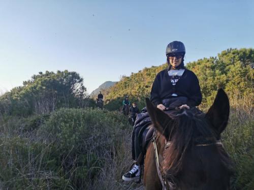 Girls on horseback during excursion