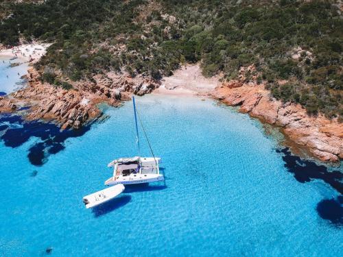 Catamaran and dinghy near the coast