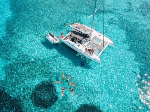 Passengers have fun aboard a catamaran