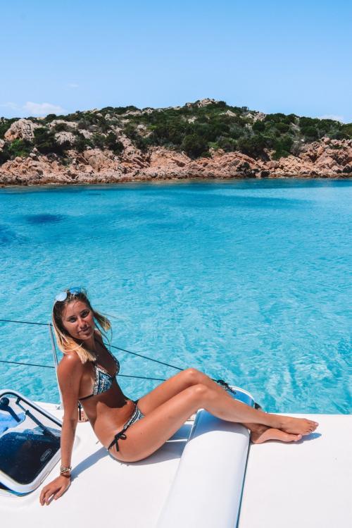 Girl aboard a catamaran in the splendid sea of La Maddalena Archipel