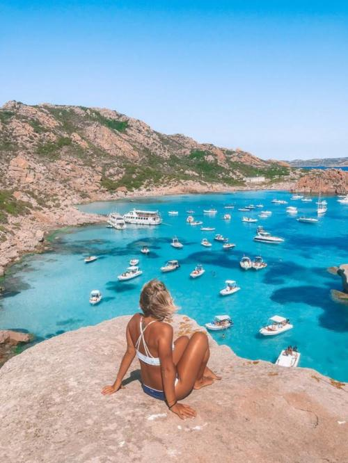 Girl and boats in the La Maddalena Archipel