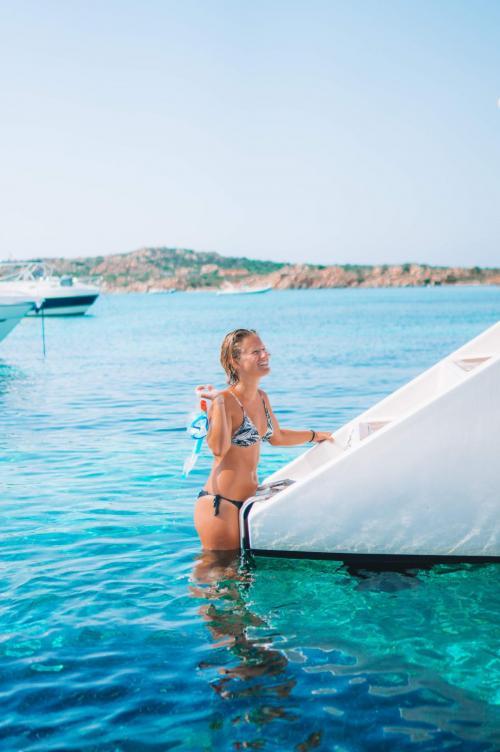 Girl gets on the catamaran