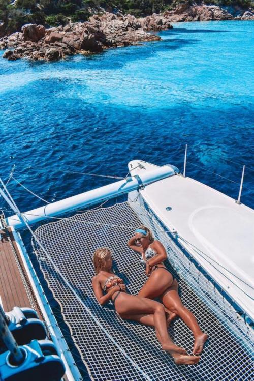Girls aboard a catamaran