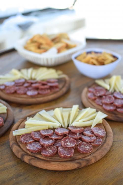 Aperitif with sausage and cheese on board a catamaran