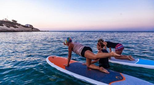 Pilates auf SUP in Balai in Porto Torres