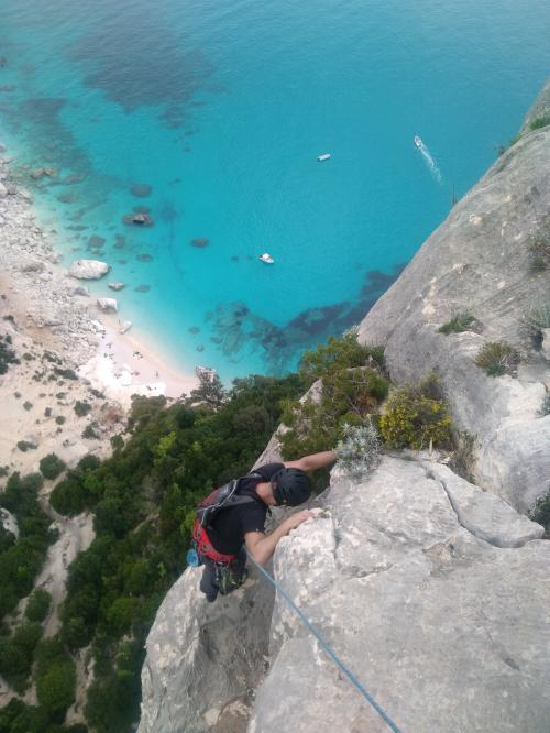 Hiker during guided climbing in the Gulf of Orosei