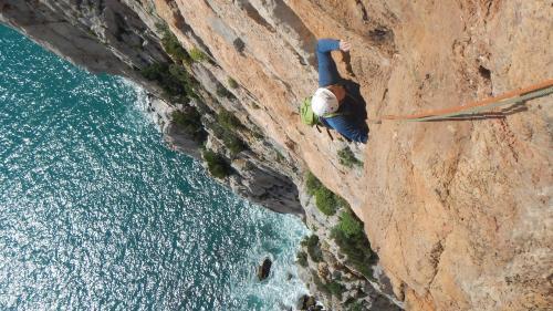 Hiker during climbing in Masua