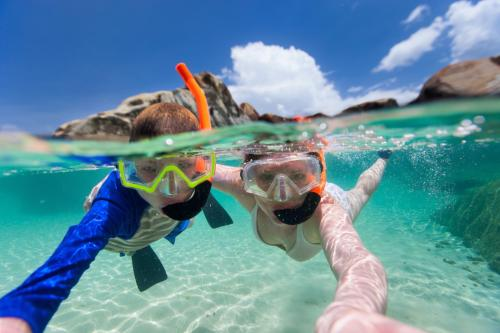 Girl and child during snorkeling excursion