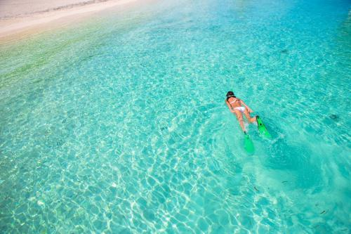 Crystal clear sea of Bosa and girl snorkeling