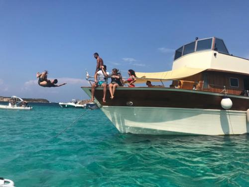 Boy dives from a motor yacht