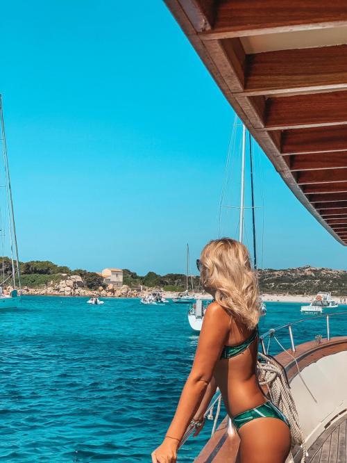 Girl on board a motor yacht