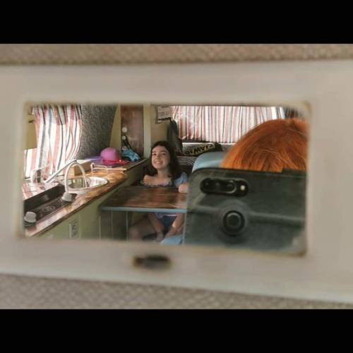 Interior of motorhome and girl
