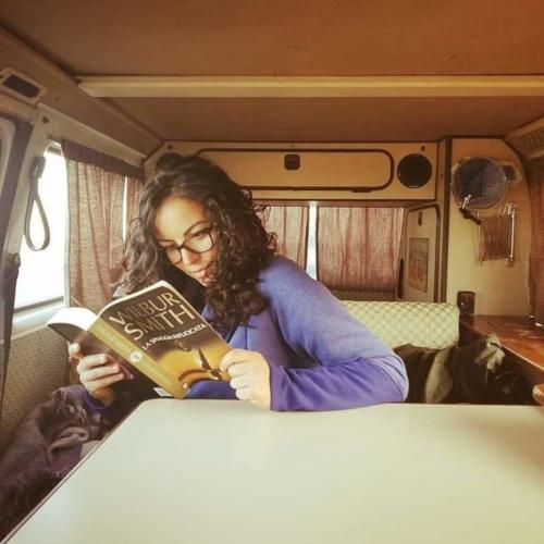 Girl reads a book on the motorhome
