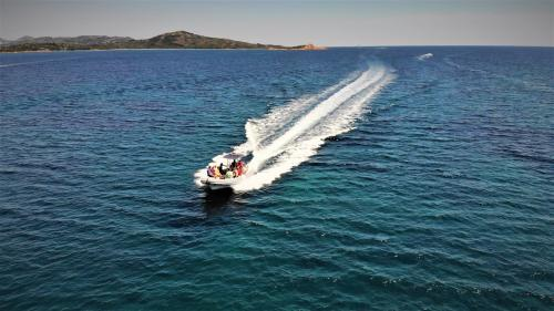 Inflatable boat sails in the sea of the island