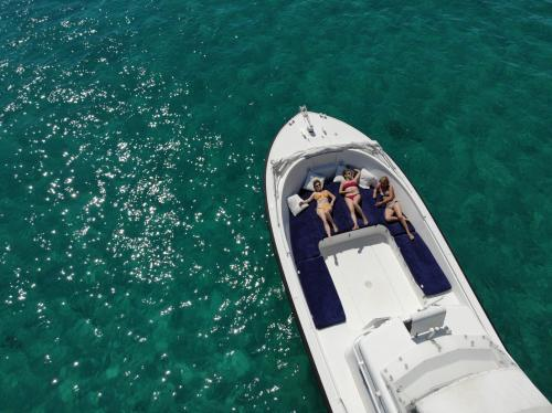 Girls relax on board an inflatable boat