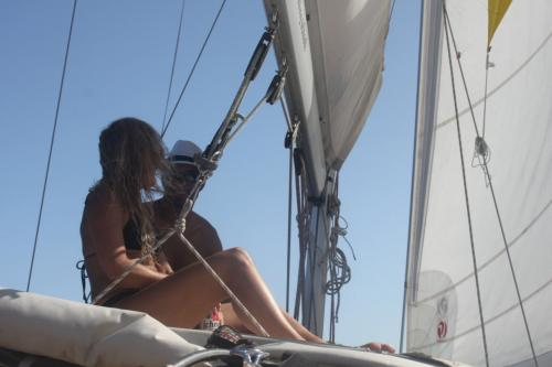 Couple aboard a sailboat