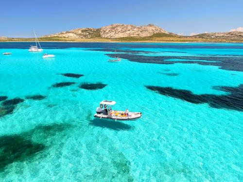 Inflatable boat in the crystal clear sea of the Gulf of Asinara
