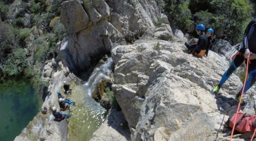 Hikers in Rio Pitrisconi during canyoning experience