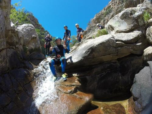 Hikers during the descent from a waterfall