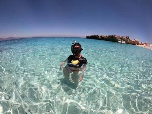 Girl snorkeling in the Gulf of Orosei