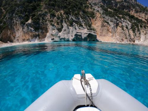 Inflatable boat in the Gulf of Orosei and crystal clear sea