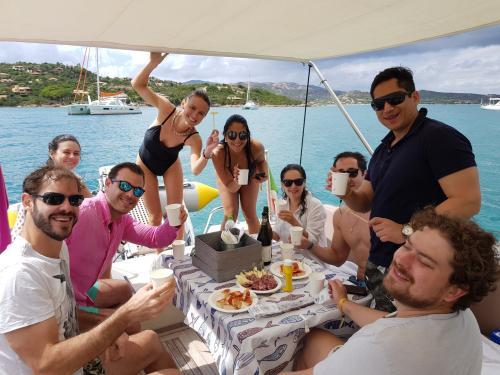 Group of friends aboard a boat in Tavolara