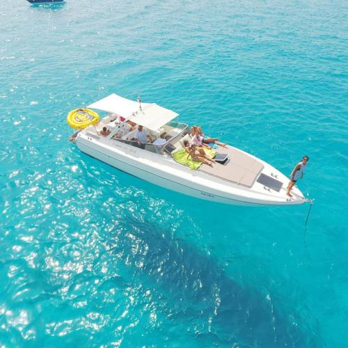 Boat in Tavolara with passengers on board