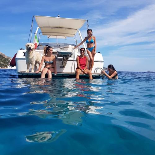 Passengers relax on board a boat during an excursion to Tavolara